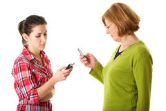 Mother and daughter checks their mobile phones Stock Image