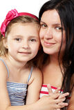 Mother and daughter cheek to cheek Royalty Free Stock Photo