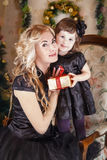 Mother and daughter cheek to cheek at Christmas Stock Image