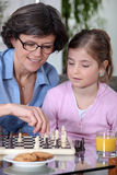 Mother daughter chess match Royalty Free Stock Photos