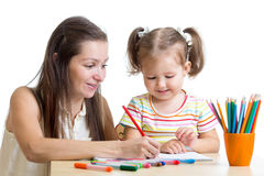 Mother and daughter child draw and paint together Stock Image