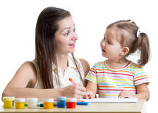 Mother and daughter child draw and paint together Royalty Free Stock Photography
