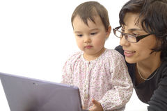 Mother and daughter child play with tablet pc Stock Photos