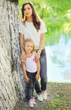 Mother and daughter child walking together in summer Royalty Free Stock Photo