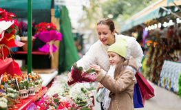 Mother and daughter choose mistletoe Stock Photo