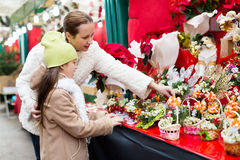Mother and daughter choose mistletoe Royalty Free Stock Images