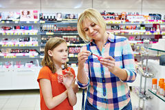 Mother and daughter choose the nail polish Stock Photography