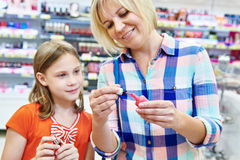 Mother and daughter choose the nail polish Stock Photos