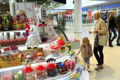 Mother and daughter choose the sweets in sweets shop stock photos