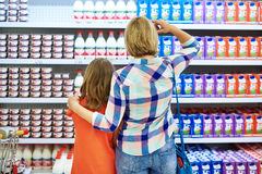 Mother and daughter choosing dairy products Royalty Free Stock Photo