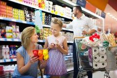 Mother and daughter choosing yogurt Stock Photo