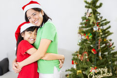 Mother and daughter on Christmas Stock Photos