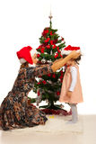 Mother and daughter at Christmas day Royalty Free Stock Photos