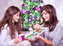 Mother with daughter in Christmas eve Stock Photos