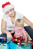 Mother and daughter with christmas gift boxes Royalty Free Stock Photo