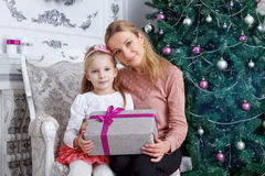 Mother and daughter with Christmas gift Stock Image