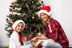 Mother and daughter at christmas Stock Photos