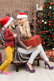 Mother , daughter in Christmas interior Stock Photo