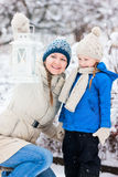 Mother and daughter with Christmas lantern Stock Photography