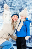 Mother and daughter with Christmas lantern Royalty Free Stock Photo