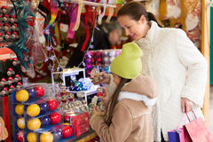 Mother with daughter in Christmas market Stock Images