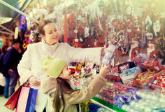 Mother with daughter in Christmas market stock photos