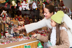 Mother with daughter in Christmas market Stock Photo
