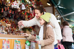 Mother with daughter in Christmas market Royalty Free Stock Photography