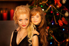 Mother and daughter on Christmas night Royalty Free Stock Photos