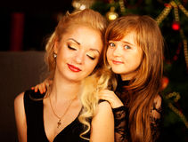 Mother and daughter on Christmas night Stock Images