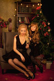 Mother and daughter on Christmas night Royalty Free Stock Photo