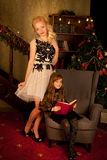 Mother and daughter on Christmas night Stock Photo