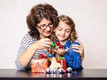 Mother and daughter Christmas present and decorations Royalty Free Stock Photography