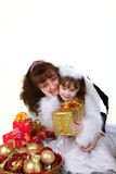 Mother with daughter and christmas toys. Isolated on white Royalty Free Stock Photos