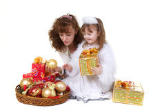 Mother with daughter and christmas toys. Isolated on white Stock Images