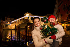 Mother and daughter with Christmas tree near Rialto Bridge Stock Photos