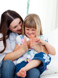 Mother and daughter clapping a goal Royalty Free Stock Photo