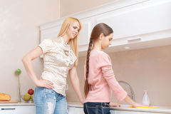 Mother and daughter cleaning the kitchen Royalty Free Stock Image
