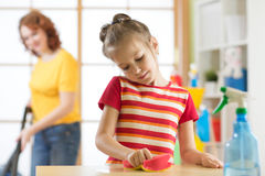 Mother and daughter cleaning in living room Royalty Free Stock Images