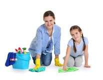 Mother and daughter with cleaning supplies, isolated. On white Stock Photography