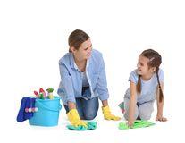 Mother and daughter with cleaning supplies, isolated. On white Royalty Free Stock Photos