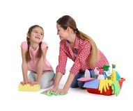 Mother and daughter with cleaning supplies, isolated. On white Royalty Free Stock Image
