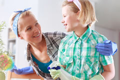 Mother and daughter cleaning their house Stock Image