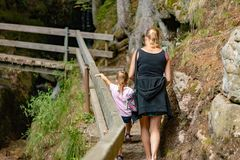 MENZENSCHWAND, GERMANY - JULY 23 2018: Mother and daughter climb royalty free stock photos