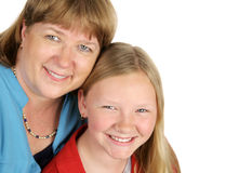 Mother & Daughter Closeup. A closeup of a blond mother and daughter.  Isolated on white with room for text Royalty Free Stock Photos