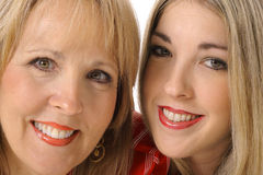 Mother daughter closeup. Isolated on white Stock Image