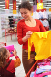 Mother with daughter in clothes shop Royalty Free Stock Image