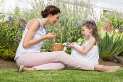Mother and daughter collecting easter eggs Royalty Free Stock Images