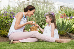 Mother and daughter collecting easter eggs Stock Photo