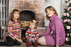 Mother and daughter in colorful knitted sweaters Royalty Free Stock Photography